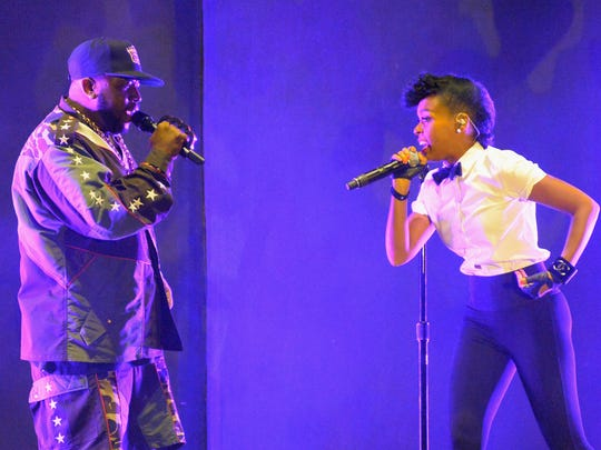 INDIO, CA - APRIL 11: Janelle Monae (R) performs onstage with Big Boi of Outkast during day 1 of the 2014 Coachella Valley Music & Arts Festival at the Empire Polo Club on April 11, 2014 in Indio, California.  (Photo by Jeff Kravitz/FilmMagic)