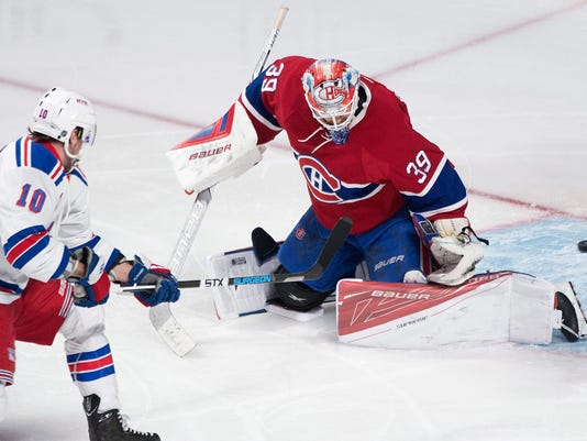 Montreal Canadiens goaltender Mike Condon gives up a goal to New York Rangers' J.T. Miller (10) during the first period of an NHL hockey game, Saturday, March 26, 2016 in Montreal.  (Graham Hughes/The Canadian Press via AP) MANDATORY CREDIT