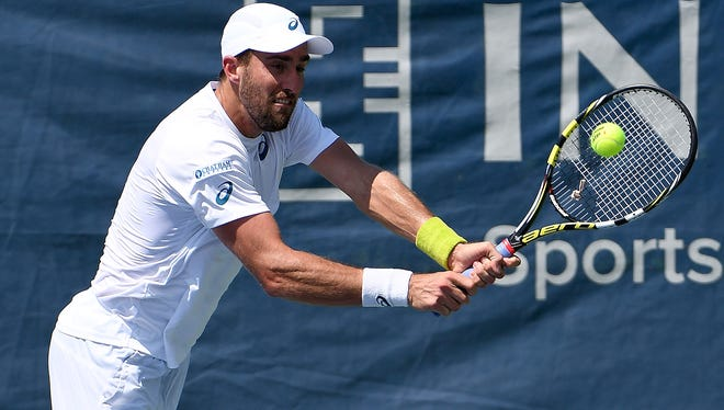 American Steve Johnson returns a shot during his loss to Ivo Karlovic in the semifinals of the Citi Open in Washington.