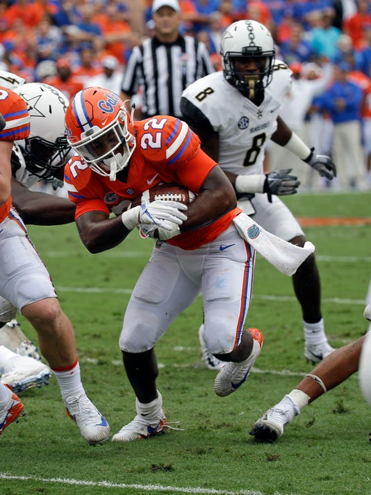 Florida running back Lamical Perine (22) runs for a 1-yard touchdown past Vanderbilt cornerback Joejuan Williams (8) during the first half of an NCAA college football game, Saturday, Sept. 30, 2017, in Gainesville, Fla. (AP Photo/John Raoux)
