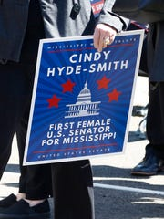 A supporter holds up a campaign sign Wednesday in Brookhaven for state Agriculture Commissioner Cindy Hyde-Smith to succeed fellow Republican Thad Cochran in the U.S. Senate. Mississippi Gov. Phil Bryant appointed Hyde-Smith to replace Cochran, who at 80, is stepping down April 1 because of poor health.