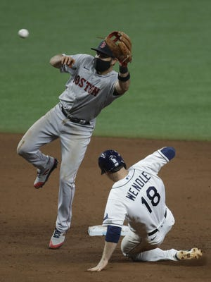 The Rays' Joey Wendle steals a base ahead of the catch by Red Sox second baseman Jose Peraza Tuesday night in Tampa, Fla.