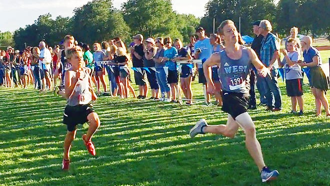 Trevor Salamon sprints to the finish in a cross crountry race for the Pueblo West Cyclones.
