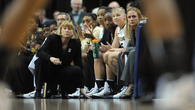 Purdue's head coach Sharon Versyp and the bench look on during the Women's Big 10 Basketball Tournament championship game Sunday, March 4, 2012,  afternoon at Banker's Life Fieldhouse. The Boilermakers defeated the Cornhuskers 74-70 in double overtime. Matt Kryger / The Star