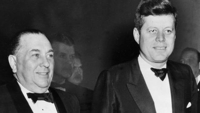 Chicago Mayor Richard J. Daley stands beside President John Kennedy in Chicago in 1963.