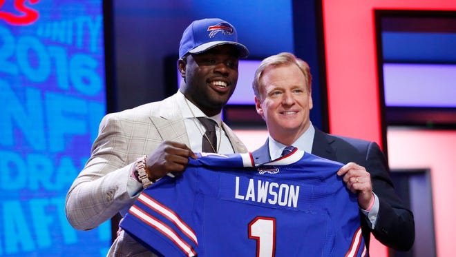 Shaq Lawson (Clemson) with NFL commissioner Roger Goodell after being selected by the Buffalo Bills as the No. 19 overall pick in the first 2016 NFL Draft.