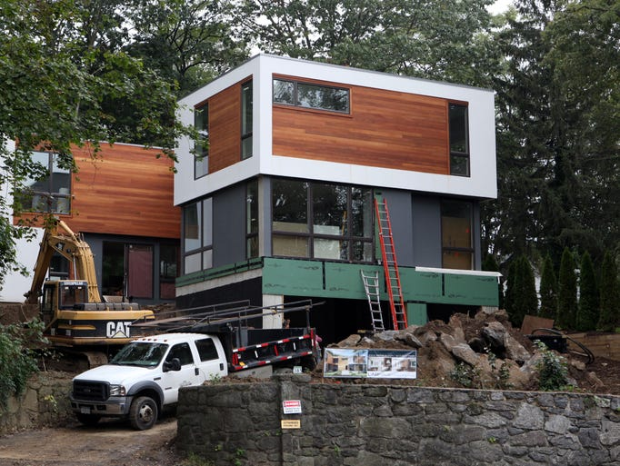 A modern, pre-fab house by LabHaus is under construction, Oct. 12, 2012 in Larchmont. ( Tania Savayan / The Journal News )