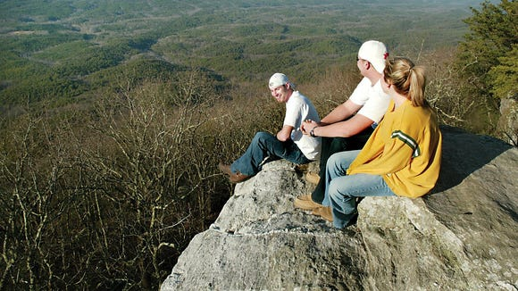 Visitors enjoy the view from Bald Rock at Cheaha State