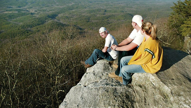 Visitors enjoy the view from Bald Rock at Cheaha State Park. The park is located in the middle of Talladega National Forest.
