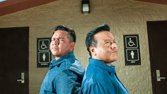 Vib Gonzales, left, and JT Perez, two transgender men who live in Las Cruces, pose for a photograph in front of a female and male restroom at Sagecrest Park on Friday, April 15, 2016. As states around the nation have recently introduced and passed legislation restricting rights of transgender people, Las Cruces is making strides towards greater inclusiveness.