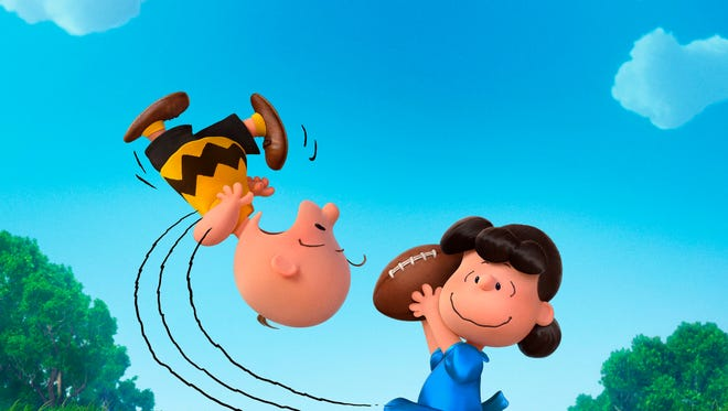 """In this photo provided by Twentieth Century Fox & Peanuts Worldwide LLC, Charlie Brown and Lucy play in the new film, """"The Peanuts Movie.""""  The movie releases in U.S. theaters Nov. 6."""