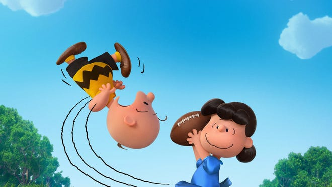 "In this photo provided by Twentieth Century Fox & Peanuts Worldwide LLC, Charlie Brown and Lucy play in the new film, ""The Peanuts Movie.""  The movie releases in U.S. theaters Nov. 6, 2015. (Twentieth Century Fox & Peanuts Worldwide LLC via AP)"