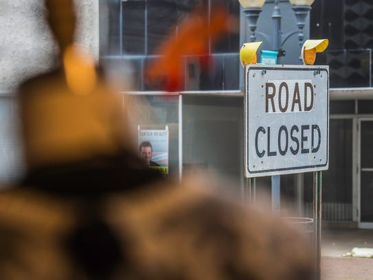 A road closure sign is seen from inside Luxe Lizzies