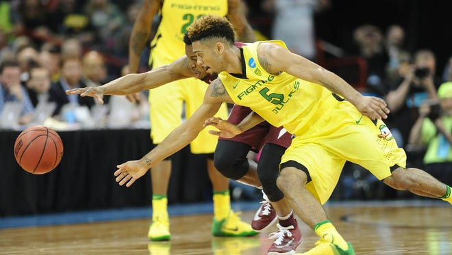 March 20, 2016; Spokane , WA, USA; Oregon Ducks guard Tyler Dorsey (5) plays for the ball against St. Joseph's Hawks forward James Demery (25) during the second half in the second round of the 2016 NCAA Tournament at Spokane Veterans Memorial Arena. Mandatory Credit: Kyle Terada-USA TODAY Sports
