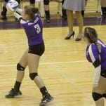 Fowlerville's Olivia Smith, left, had eight kills in her team's 3-1 loss to Lansing Catholic in the district finals at Williamston on Friday.