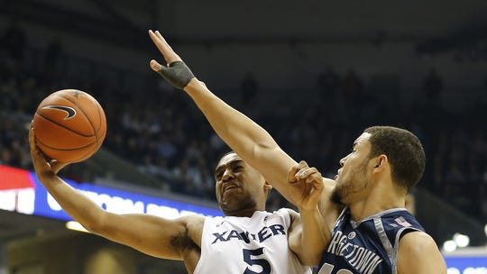 Xavier Musketeers guard Trevon Bluiett (5) is fouled