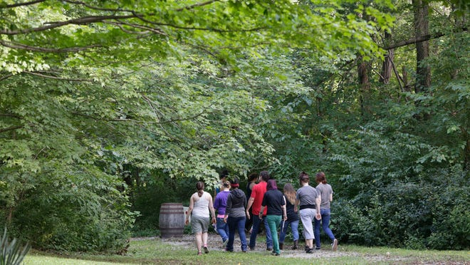 Girls from Maryhurst walk a trail at Blackacre while participating in a Harnessing the Healing Power of Nature program.