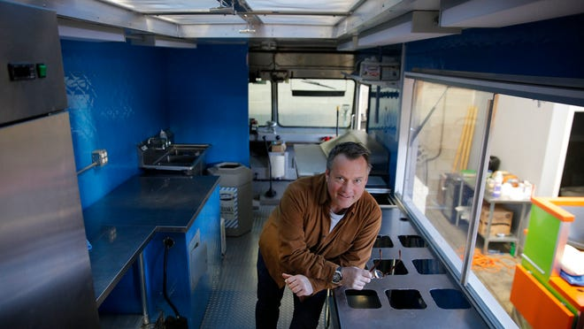 In this 2012 photo, M Design Vehicles owner Ian Macdonald in an Abbott's Ice Cream food truck his company rehabbed at its Emerson Road facility.