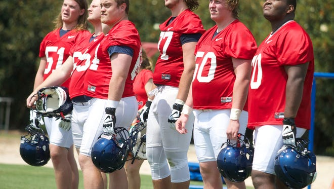 Some of Ole Miss' offensive linemen, including freshmen Sean Rawlings and Jordan Sims, far right, watch part of Saturday's practice.