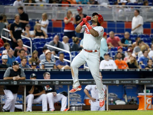 Philadelphia Phillies' Maikel Franco leaps as he heads for home after hitting a home run during the eighth inning against the Miami Marlins in a baseball game, Tuesday, July 18, 2017, in Miami. Franco had three hits, including the tie-breaking home run in the eighth, to help lift the Phillies to a 5-2 victory. (AP Photo/Wilfredo Lee)