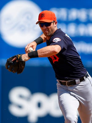 Mar 22, 2017; Dunedin, FL, USA; Tigers infielder Andrew Romine throws to first base against the Blue Jays in the sixth inning at Florida Auto Exchange Stadium.