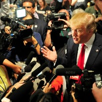 Republican presidential candidate Donald Trump talks with the media after his speech at the National Federation of Republican Assemblies at Rocketown.