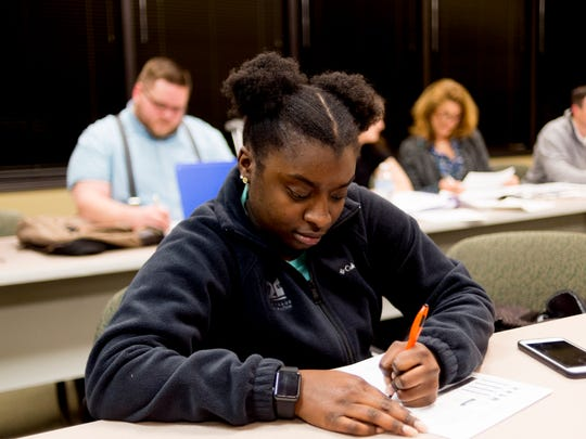 Derrica Echols, of Knoxville, fills out a worksheet in Dr. Stella Schramm's finance class at Tusculum College on Lovell Road in Knoxville, Tennessee on Wednesday, December 6, 2017. Tusculum College is expanding to a university with the addition of four doctoral and masters programs in health sciences.
