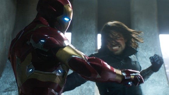 """This image released by Disney shows Robert Downey Jr., left, and Sebastian Stan in a scene from Marvel's """"Captain America: Civil War."""""""