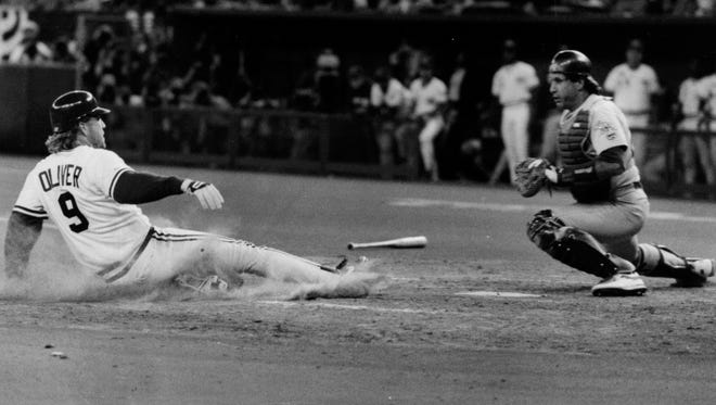 Joe Oliver scores from second on a Ron Oester double in the fourth inning of World Series Game 2 at Riverfront Stadium, Cincinnati, Ohio.