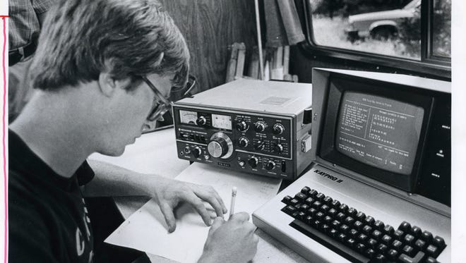 Jonathan Dowell of the Southwest Missouri Radio Club transcribes a message from his computer during the American Radio Relay League's Field Day competition in June of 1984.
