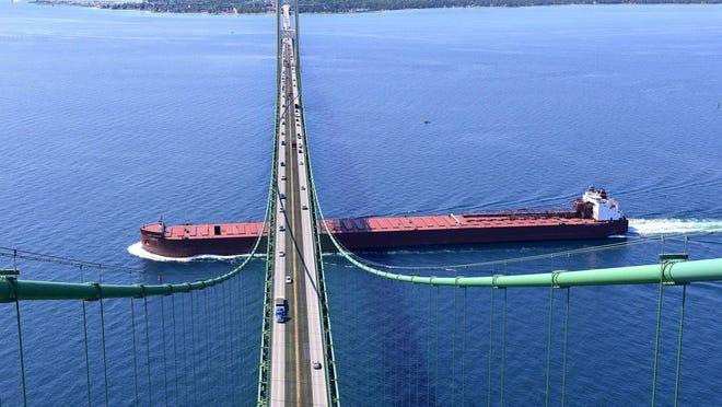 The 1000-foot James R. Barker passes from Lake Michigan to Lake Huron through the Straits of Mackinac under the Mackinac Bridge on July 10, 2014. (Lansing State Journal | Rod Sanford)