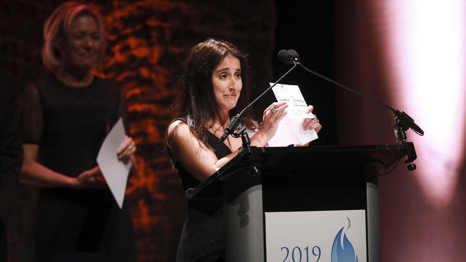 Bak Middle School of the Arts teacher Jaimee Stamile receives the Dwyer Award for Special Programs at the Kravis Center in May 2019.