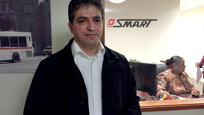 Mazyn Barash stands in front of the SMART offices in downtown Detroit in January. Barash's legal fight against SMART is nearing an end. The former bus mechanic was harassed because of his Chaldean ethnicity.