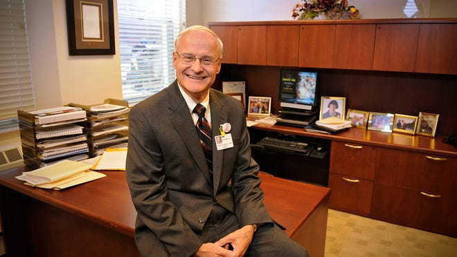 CentraCare Health President Terry Pladson smiles in his office at the St. Cloud Hospital Friday. Pladson is retiring Dec. 31.