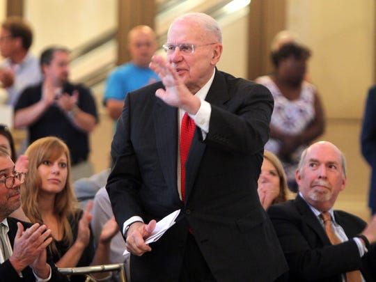 Otto M. Budig, Jr., board chair of the Music Hall Revitalization Co., acknowledges applause at a briefing at Music Hall in 2015.