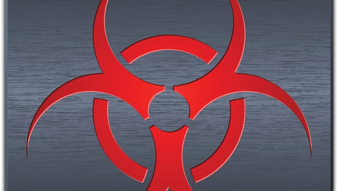Vector biohazard sign on dark metal plate