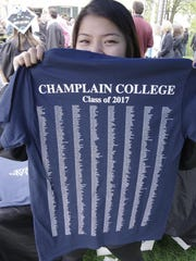 A Champlain College graduation shows off her Class of 2017 T-shirt.