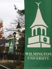 The bell tower of the Pratt Student Center is displayed on banners throughout the Wilmington University campus.