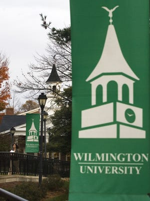 The bell tower of the Pratt Student Center is displayed on banners throughout the Wilmington University campus near New Castle in 2009.