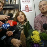 Belarusian journalist and writer Svetlana Alexievich, the 2015 Nobel literature winner, center, is surrounded after a news conference Thursday in Minsk, Belarus.