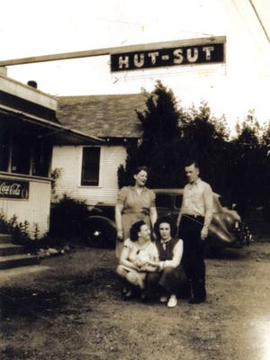 Many of Kitsap's eateries and road houses of the 1940s and '50s had colorful-sounding names. Shown here in 1945 is the Hut Sut Café on Kitsap Way with owner Ted Johnson and three waitresses. The cafe's specialties were steaks and fried chicken. To see more photos from the Kitsap County Historical Society Museum archives, visit facebook.com/kitsaphistory, kitsapmuseum.org, or stop by  the museum at 280 Fourth St. in Bremerton. Call 360-479-6226 for information.