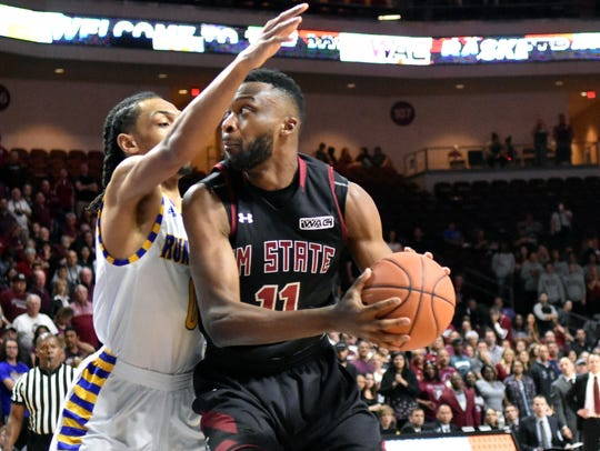 New Mexico State's Johnathon Wilkins looks for an open