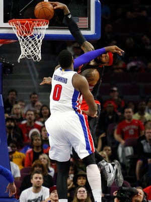 Toronto Raptors forward James Johnson (3) dunks the ball as Detroit Pistons center Andre Drummond defends during the fourth quarter at The Palace of Auburn Hills.