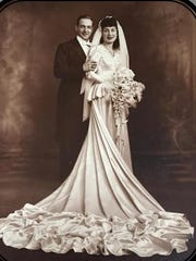 The Lasners, celebrating their 71st wedding anniversary, in their wedding portrait.