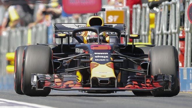 The halo device on Daniel Ricciardo's Red Bull Racing car can be seen as he returns to the pits during practice for the 2018 Australian Grand Prix.