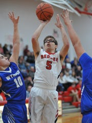 Bucyrus' Derek Heinlen puts up a contested jumper.
