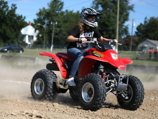 Emily Edwards competes in the drag race competition during the ATV Jamboree at the Pocomoke Fairgrounds in 2012.