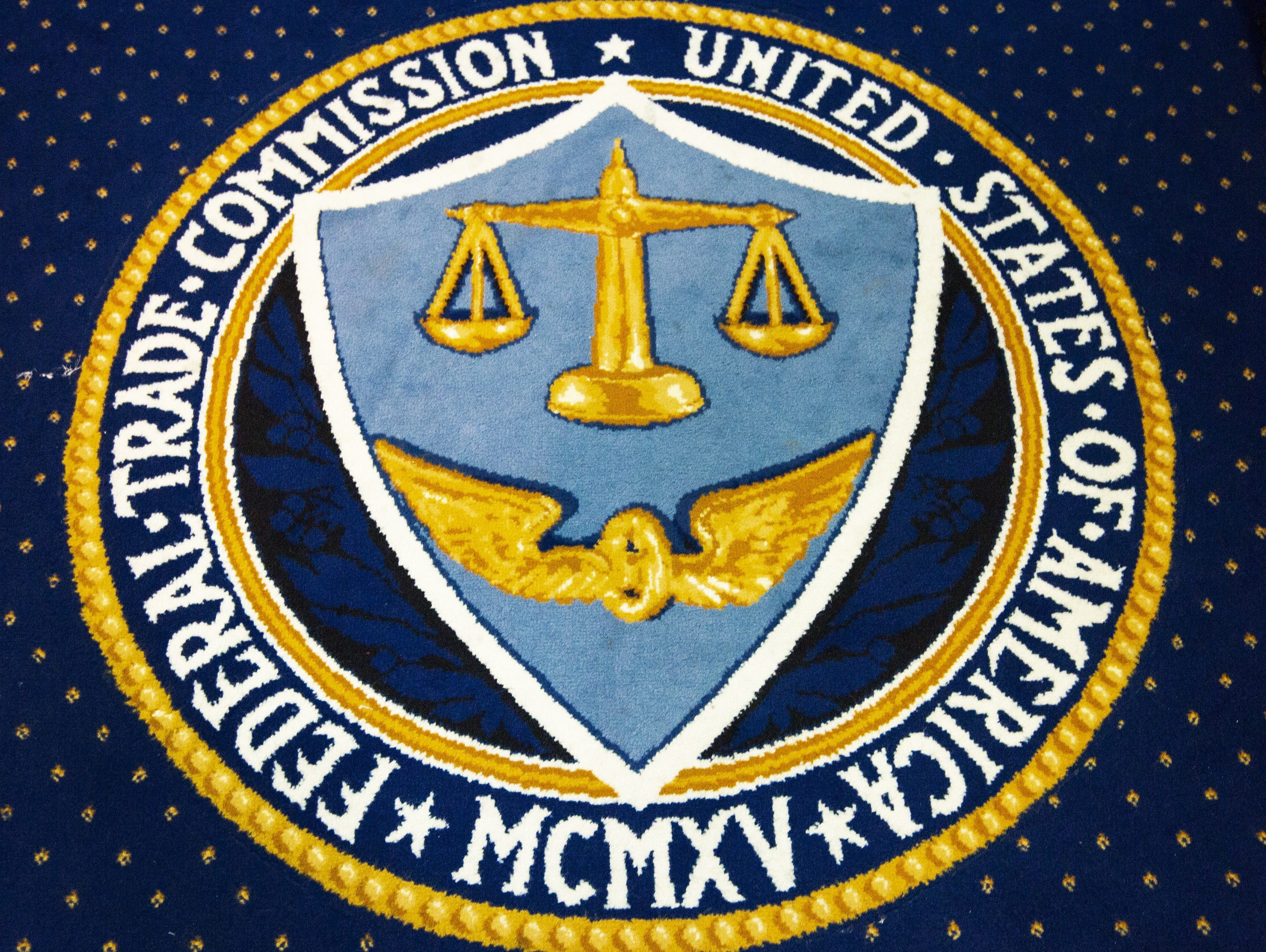 The logo of the Federal Trade Commission is seen sewn into the carpet in their Commissioner's Conference Room inside the FTC headquarters in Washington, D.C.