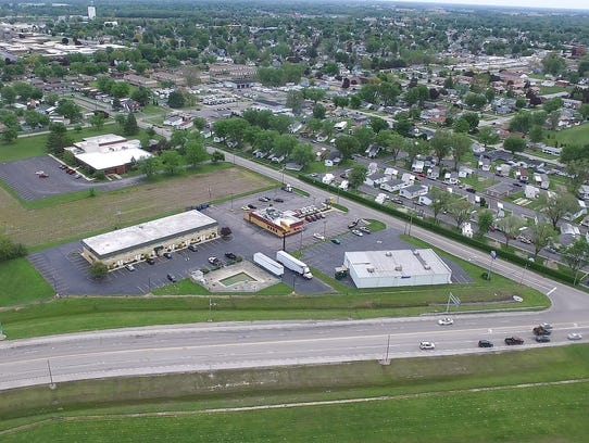 This file photo shows an aerial view of the proposed Kroger Marketplace site on Cedar Street.