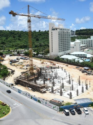 An overview look of the construction site of the Tsubaki Tower, as seen in Tumon, on Wednesday, Aug. 23, 2017. The hotel project, started in March 2016 by Tokyo real estate giant Ken Corp., is slated to reach a height of 26-stories and cost an estimated $150 million to build, according to Pacific Daily News files. According to subcontractor 5M Construction, the project has been delayed because of manpower problems.